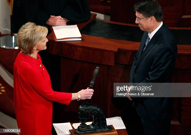 North Carolina Gov Bev Perdue left smiles with GovElect Pat McCrory prior to handing the state seal over to McCrory and before he is officially sworn...