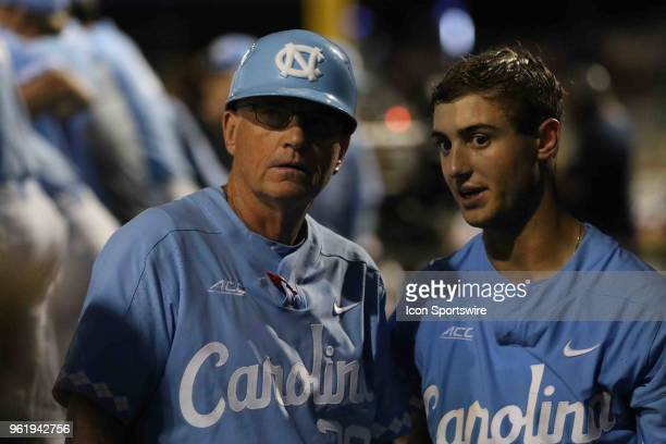 North Carolina Head Coach Miek Fox and North Carolina catcher Brandon Martorano talking in the dugout during the ACC Baseball Championship game...