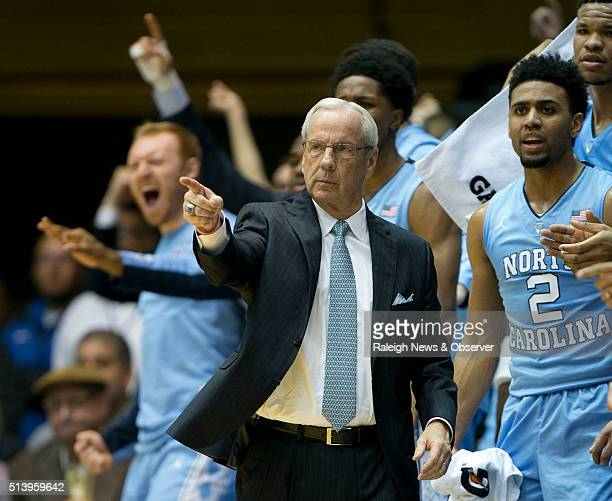 North Carolina head coach Roy Williams and the Tar Heels' bench enjoy a 10point lead against Duke during the first half at Cameron Indoor Stadium in...