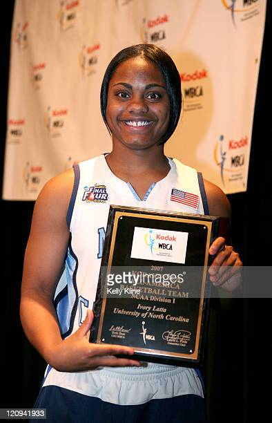 North Carolina Ivory Latta holds her 2007 Kodak WBCA AllAmerica plague at the Marriott Hotel Cleveland Ohio March 31 2007
