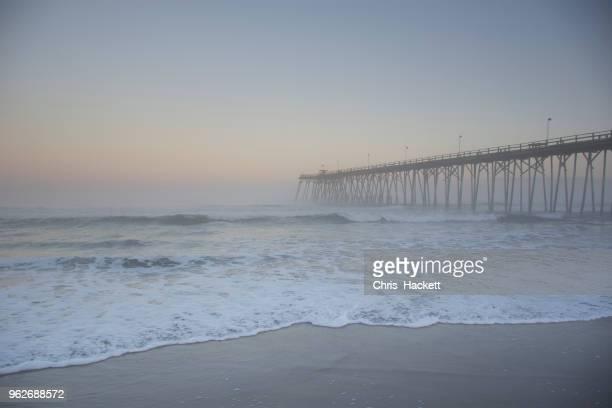 usa, north carolina, jetty in kure beach at dusk - hackett stock photos and pictures