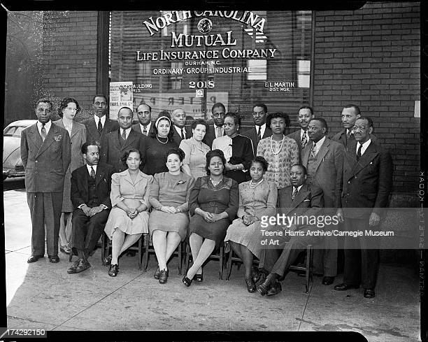 North Carolina Mutual Life Insurance Company employees, first row from left: E. B. Davis, N. P. Johnson, Odiell D. Posey, M. I. Lowe, T. Y....