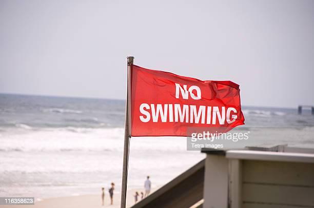 USA, North Carolina, Outer Banks, Kill Devil Hills, no swimming sign on beach