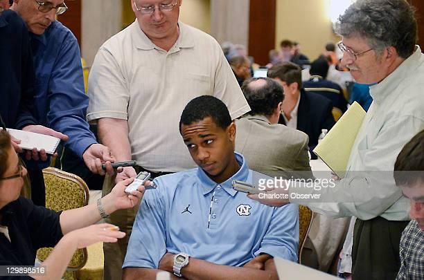 North Carolina player John Henson talks with the media during am ACC Operation Basketball event at the Ritz-Carlton in Charlotte, North Carolina,...