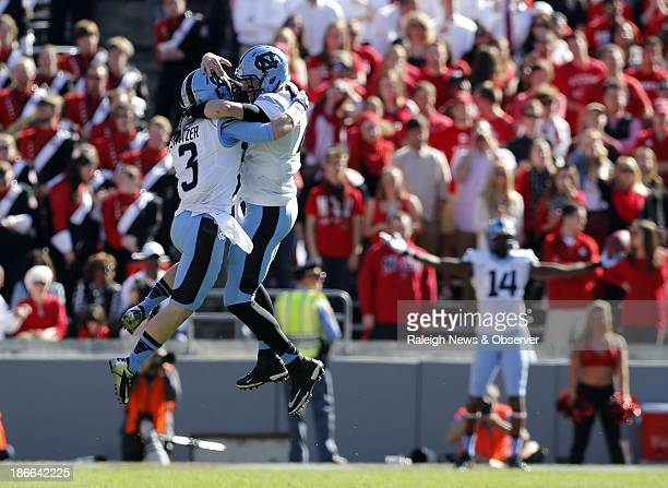 North Carolina quarterback Bryn Renner right celebrates with Ryan Switzer who threw a 59yard touchdown pass during the first half against NC State at...