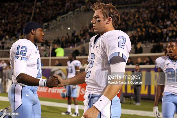 North Carolina quarterback Bryn Renner shakes hands with Charles Brown prior to the Tar Heels game against East Carolina on Saturday October 31 2011...
