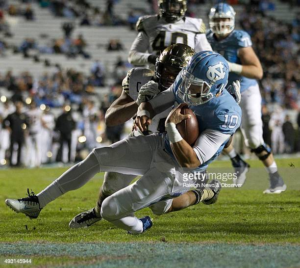North Carolina quarterback Mitch Trubisky scores on a 10yard run in the fourth quarter against Wake Forest on Saturday Oct 17 at Kenan Stadium in...
