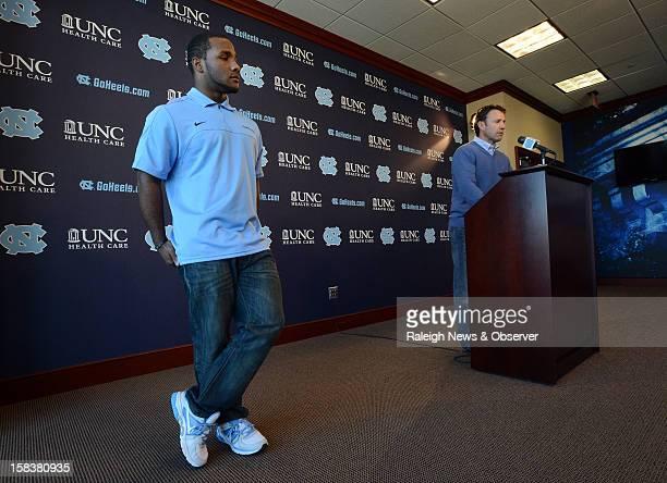 North Carolina running back Giovani Bernard left listens as UNC head coach Larry Fedora speaks to the media in Chapel Hill North Carolina on Friday...