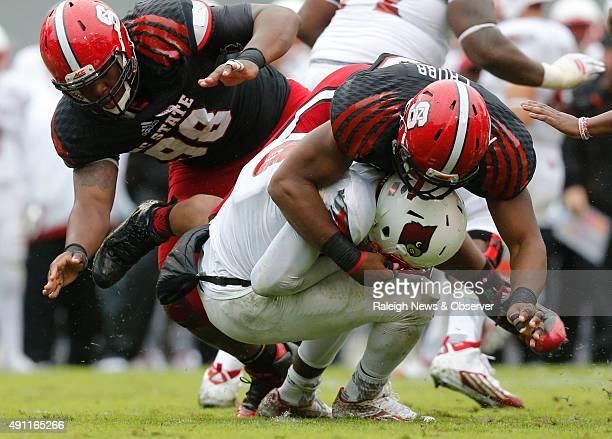 North Carolina State defensive end Bradley Chubb sacks Louisville quarterback Lamar Jackson during the second half at CarterFinley Stadium in Raleigh...