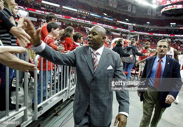 North Carolina State head coach Sidney Lowe highfives fans as he walks off the court following a 7974 victory over Georgia Tech at the RBC Center in...