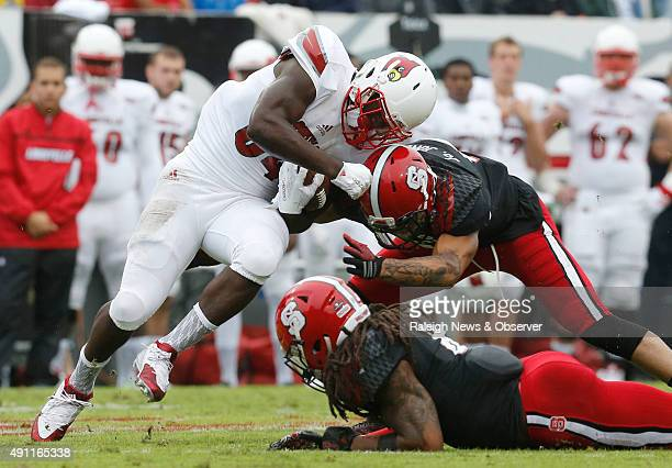 North Carolina State safety Josh Jones stops Louisville running back Jeremy Smith during the first half at CarterFinley Stadium in Raleigh NC on...