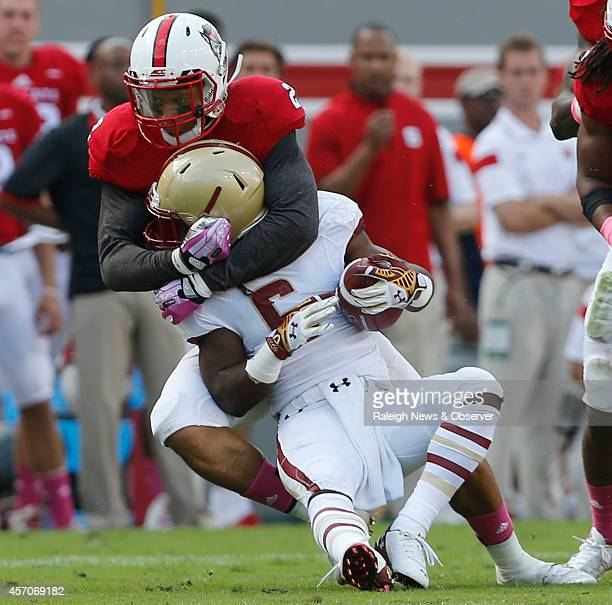 North Carolina State safety Josh Jones tackles Boston College's Sherman Alston during the first half at CarterFinley Stadium in Raleigh NC Saturday...