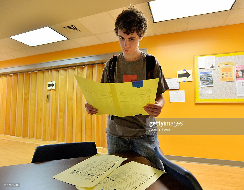 North Carolina State University senior Jonathan Powell reviews sample ballots before voting in the primaries at Pullen Community Center on March 15, 2016 in Raleigh, North Carolina. The North Carolina primaries is the state's first use of the voter ID law, which excludes student ID cards. Wake County was among the highest use of provisional ballots, where those voters had home addresses on or near campuses. The Board of Elections will review voter's reasonable impediment form submitted with their provisional ballots to determine if their vote counts. The state's voter ID law is still being argued in federal court.
