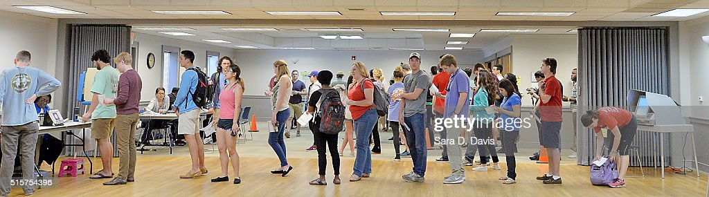 North Carolina State University students stand in line to receive their ballots at Pullen Community Center on March 15, 2016 in Raleigh, North Carolina. The North Carolina primaries is the state's first use of the voter ID law, which excludes student ID cards. Wake County was among the highest use of provisional ballots, where those voters had home addresses on or near campuses. The state's voter ID law is still being argued in federal court.
