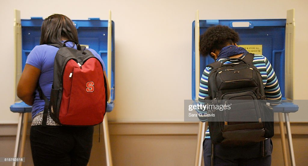 North Carolina State University students vote in the primaries at Pullen Community Center on March 15, 2016 in Raleigh, North Carolina. The North Carolina primaries is the state's first use of the voter ID law, which excludes student ID cards. Wake County was among the highest use of provisional ballots, where those voters had home addresses on or near campuses. The state's voter ID law is still being argued in federal court.