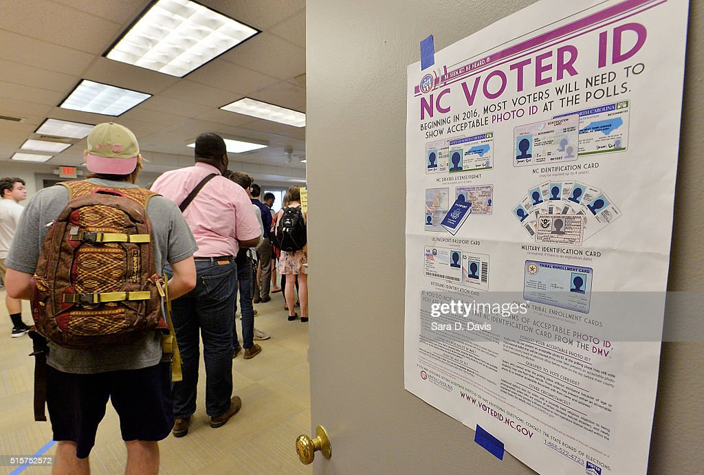 North Carolina State University students wait in line to vote in the primaries at Pullen Community Center on March 15, 2016 in Raleigh, North Carolina. The North Carolina primaries is the state's first use of the voter ID law, which excludes student ID cards. Wake County was among the highest use of provisional ballots, where those voters had home addresses on or near campuses. The Board of Elections will review voter's reasonable impediment form submitted with their provisional ballots to determine if their vote counts. The state's voter ID law is still being argued in federal court.