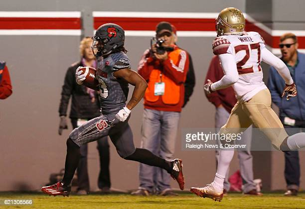 North Carolina State wide receiver Bra'Lon Cherry beats Florida State's defensive back Marquez White with a 28yard touchdown reception during the...