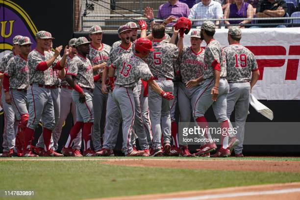 North Carolina State Wolfpack catcher Patrick Bailey is congratulated by teammates after homering in the first inning during a game between the East...