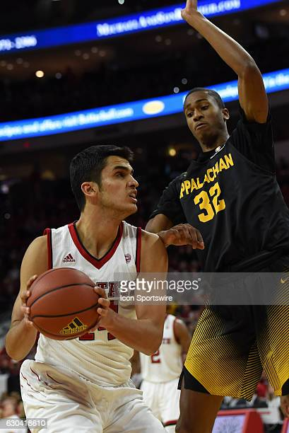 North Carolina State Wolfpack center Omer Yurtseven head fakes against Appalachian State Mountaineers forward Tyrell Johnson during the first half of...
