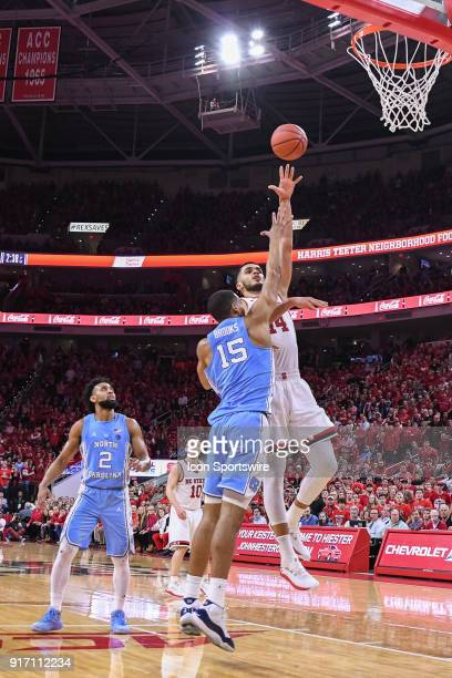 North Carolina State Wolfpack center Omer Yurtseven with the short jumper as North Carolina Tar Heels forward Garrison Brooks defends during the...