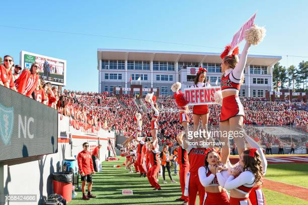 North Carolina State Wolfpack Cheerleaders get the fans into the game during the college football game between the Florida State Seminoles and the...