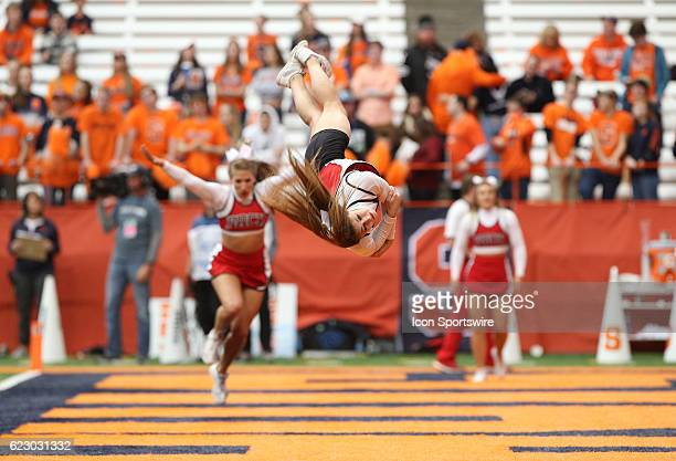 North Carolina State Wolfpack cheerleaders somersault during a NCAA football game between the North Carolina State Wolfpack and the Syracuse Orange...