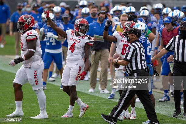 North Carolina State Wolfpack cornerback Cecil Powell signals for fourth down during the TaxSlayer Gator Bowl game between the North Carolina State...
