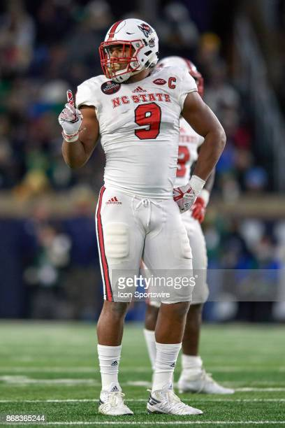 North Carolina State Wolfpack defensive end Bradley Chubb gestures to the sidelines during the college football game between the Notre Dame Fighting...
