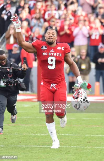 North Carolina State Wolfpack defensive end Bradley Chubb runs on to the field for senior day prior to the game between the North Carolina Tarheels...