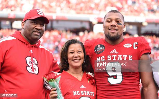 North Carolina State Wolfpack defensive end Bradley Chubb stands with his family prior to the game between the North Carolina Tarheels and the NC...