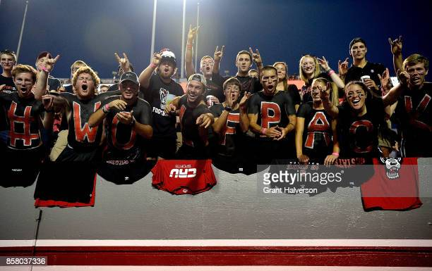 North Carolina State Wolfpack fans cheer during the game against the Louisville Cardinals at Carter Finley Stadium on October 5 2017 in Raleigh North...