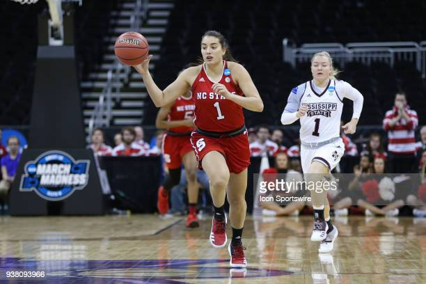 North Carolina State Wolfpack guard Aislinn Konig brings the ball upcourt in the first quarter of a third round NCAA Division l Women's Championship...