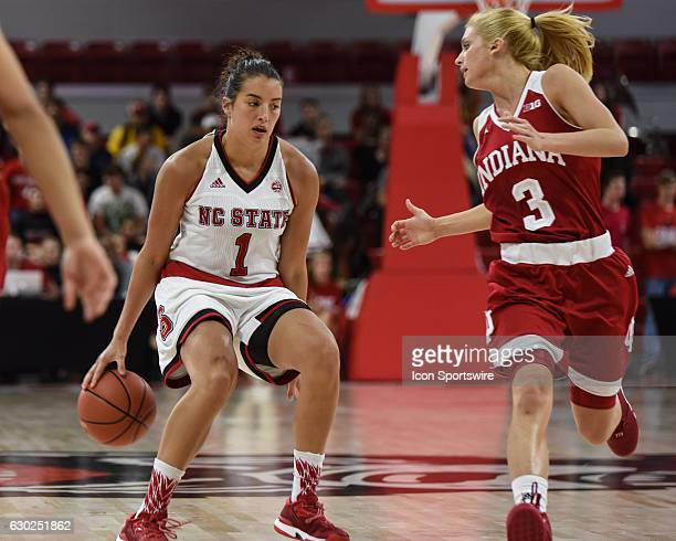 North Carolina State Wolfpack guard Aislinn Konig dribbles behind her back to advance up the court during the second half of the ACC/Big10 Challenge...
