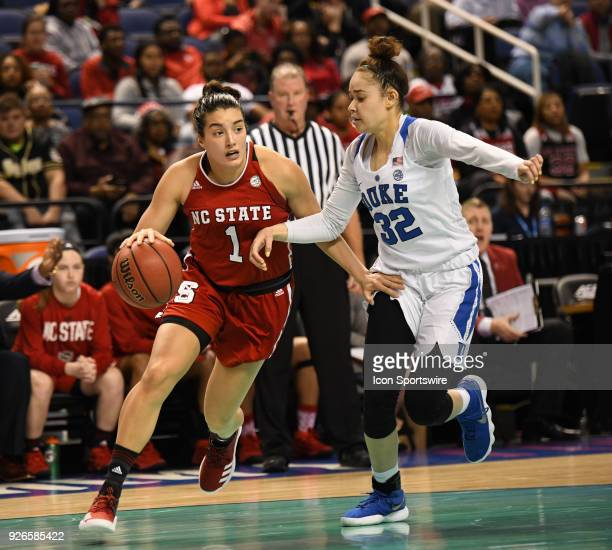 North Carolina State Wolfpack guard Aislinn Konig drives by Duke Blue Devils guard Jayda Adams during the ACC women's tournament game between the NC...