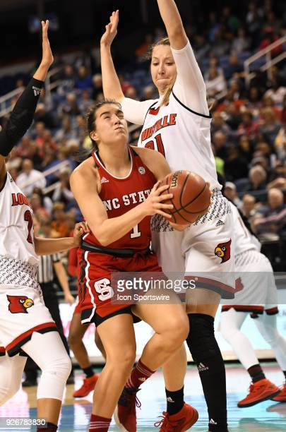 North Carolina State Wolfpack guard Aislinn Konig drives through traffic during the ACC women's tournament game between the NC State Wolfpack and the...