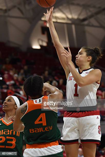 North Carolina State Wolfpack guard Aislinn Konig shoots over Miami Hurricanes guard Shaneese Bailey during the game between the Miami Hurricanes and...