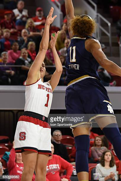 North Carolina State Wolfpack guard Aislinn Konig shoots over Notre Dame Fighting Irish forward Brianna Turner during the game between the Notre Dame...