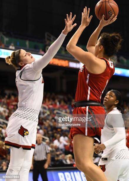 North Carolina State Wolfpack guard Aislinn Konig shoots over Louisville Cardinals forward Sam Fuehring during the ACC women's tournament game...