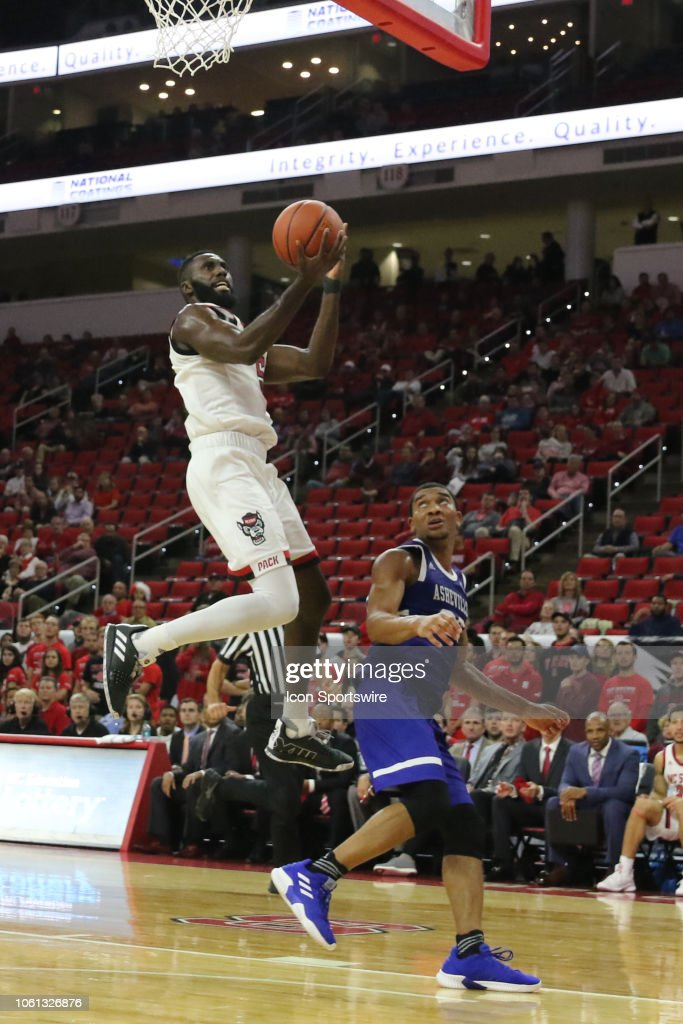 North Carolina State Wolfpack guard Eric Lockett goes to