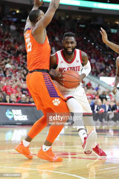 North Carolina State Wolfpack guard Eric Lockett with the ball pushing past Clemson Tigers forward Aamir Simms during the 1st half of the NC State...