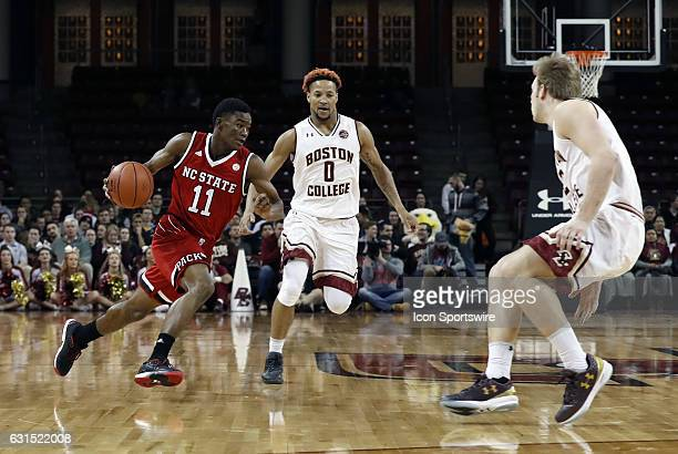 North Carolina State Wolfpack guard Markell Johnson dribbles between Boston College guard Ky Bowman and Boston College forward Connar Tava during an...
