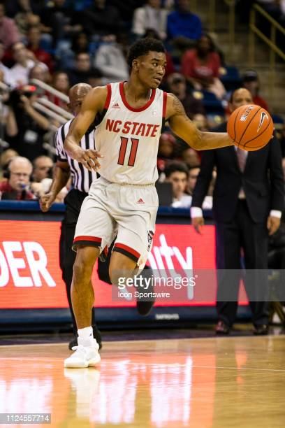 North Carolina State Wolfpack guard Markell Johnson dribbles the ball uo court during the college basketball game between the North Carolina State...