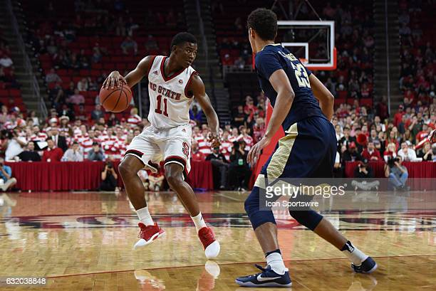 North Carolina State Wolfpack guard Markell Johnson dribbles with Pittsburgh Panthers guard Cameron Johnson guarding during a game between the...