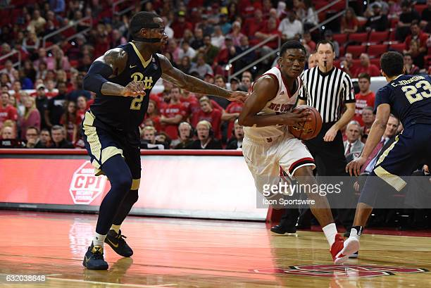 North Carolina State Wolfpack guard Markell Johnson drives around Pittsburgh Panthers forward Michael Young during a game between the Pittsburgh...