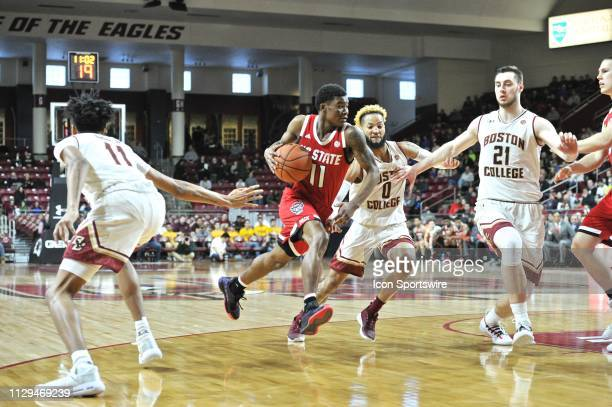 North Carolina State Wolfpack guard Markell Johnson drives hard past Boston College Eagles guard Ky Bowman with the rock During the North Carolina...