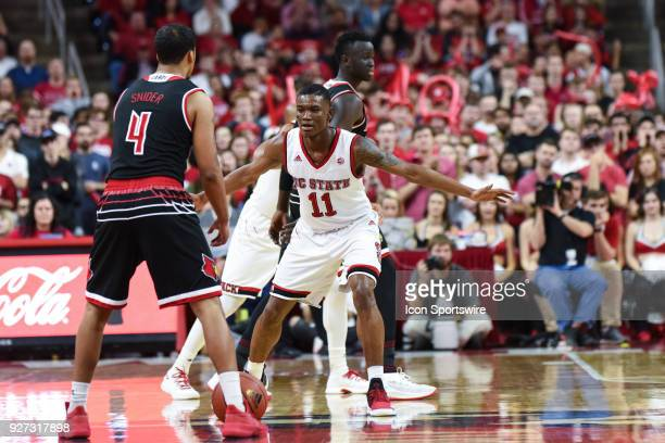 North Carolina State Wolfpack guard Markell Johnson guards Louisville Cardinals guard Quentin Snider during the men's college basketball game between...