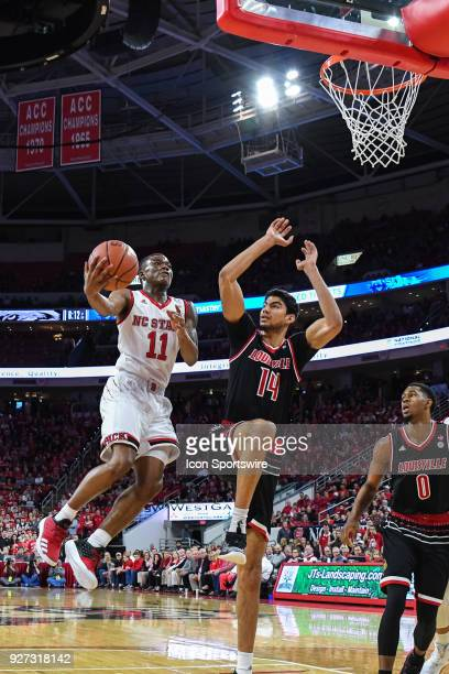 North Carolina State Wolfpack guard Markell Johnson leaps for the basket as Louisville Cardinals forward Anas Mahmoud goes for the block during the...