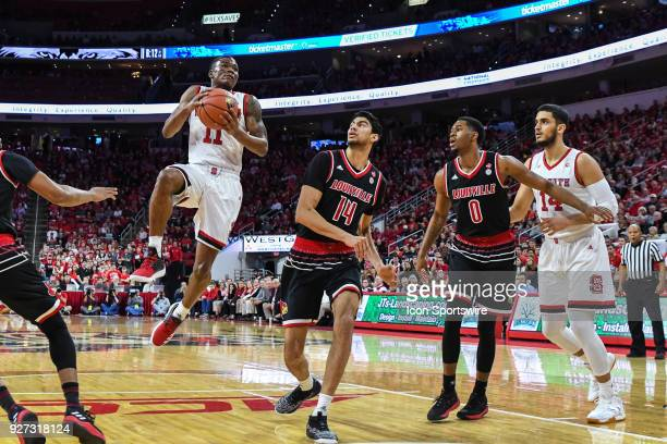 North Carolina State Wolfpack guard Markell Johnson leaps for the basket during the men's college basketball game between the Louisville Cardinals...