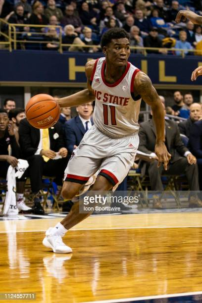 North Carolina State Wolfpack guard Markell Johnson looks to pass during the college basketball game between the North Carolina State Wolfpack and...