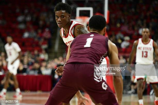 North Carolina State Wolfpack guard Markell Johnson pressures Arkansas Little Rock Trojans guard Markquis Nowell in the back court during the game...
